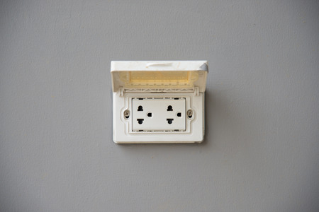 Thailand plug socket with the cover protection on grey background photo