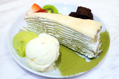 ice cram: Uji Matcha Crepes Cake with vanilla ice cram, brownies and fruits topping