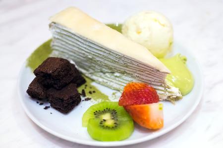 cram: Uji Matcha Crepes Cake with vanilla ice cram, brownies and fruits topping