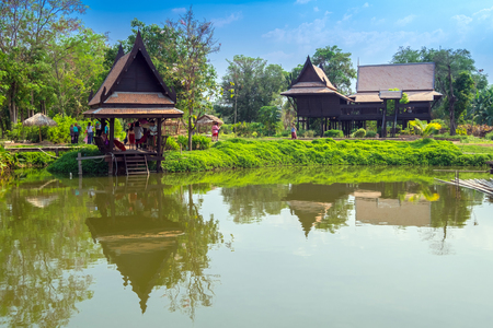 Thai house style that make from wood stand alone in garden, Thailand