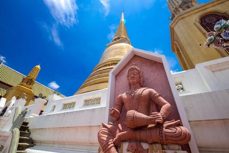 Beautiful golden pagoda and statue in Wat Bowonniwet Vihara, Bangkok