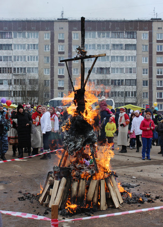 merrymaking: Russian folk holiday Maslenitsa, in Gatchina, Leningrad Region, March 13, 2016. Russian Binge. Farewell to winter, meeting spring. Burning effigies of Carnival (Shrovetide, Scarecrow). Festivities. Slavic holiday beginning of spring. Editorial
