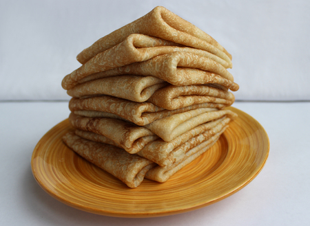 heathen: Pancakes with butter on a plate, as a symbol of ancient Slavic celebration of Carnival. Meet spring, winter farewell.