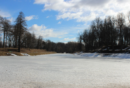melting ice: Karpin pond, covered with melting ice in spring Gatchina Park, 2016.