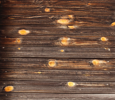innate: The texture of pure wood on the wall of an ordinary old wooden house, village Nizovskaya, Leningrad region, Russia. Stock Photo