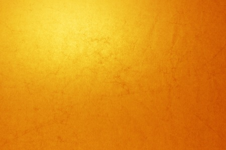 crinkly: yellow paper texture illuminated by a lamp behind Stock Photo