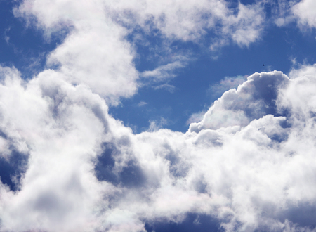 flaying: Nice white curly clouds on a blue sky Stock Photo