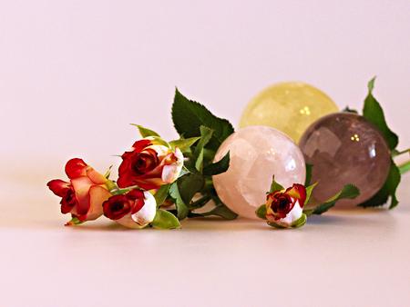citrine: macro photo bush mottled red rose and mineral stones - kyanite, citrine, amethyst