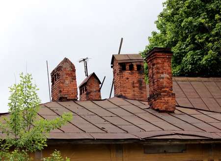 cement chimney: old brick pipe on historical non-residential building in the city of Gatchina