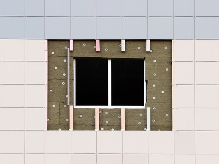 window in a newly built house. wall structure with insulated non-combustible material basalt fiber tiled.