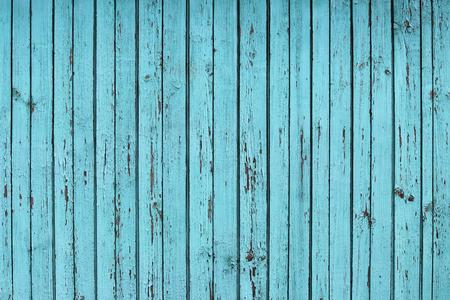 textura: trama della vecchia recinzione di legno blu che protegge la terra