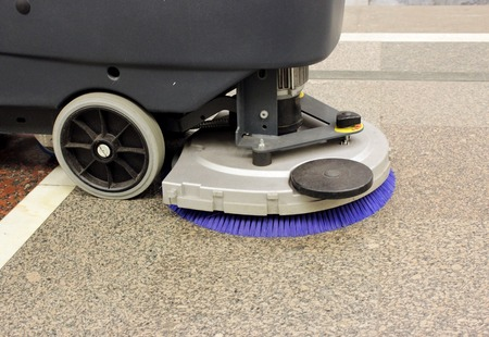 janitorial: Brush in the battery scrubber-dryer in the metro Moscow Stock Photo