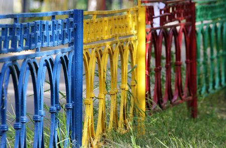 resistant: multicolored metal fence made of red, yellow, green, and blue colors