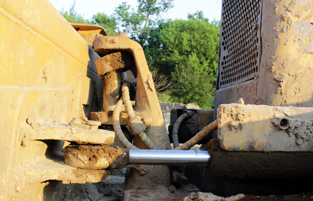 hydraulic hoses: hydraulic hoses on a piston against the hydraulic system in the bulldozer Stock Photo