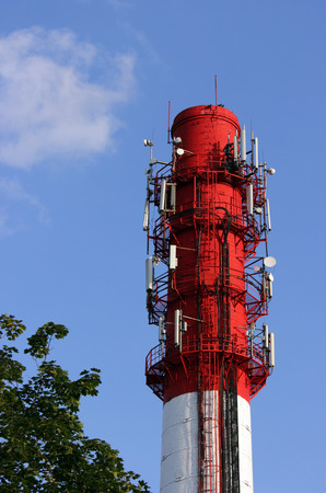 primarily: Red and white tube boiler with cables of telecommunications equipment primarily for cellular transmission