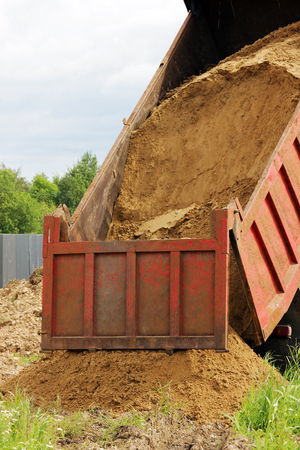 trenches: truck is unloading sand for backfilling trenches with the pipeline after the accident.