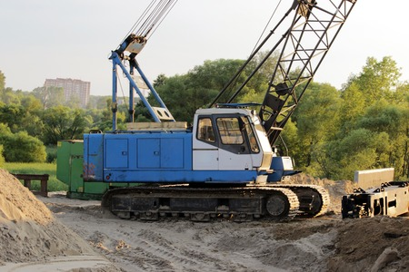 crawler: heavy crawler blue crane at the construction site for the construction of road transport interchanges in Moscow