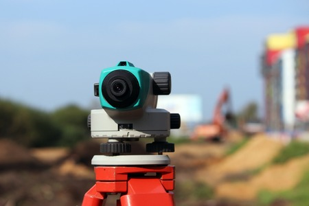 geodetic: Leveler - a device for detecting the marks on the ground, the calculation of longitudinal and transverse slope, to make the construction site completely horizontal position relative to the sea level. Stock Photo