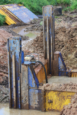 metal structural immediate support and pump that pumps the water to drain areas on the stretch of road construction.