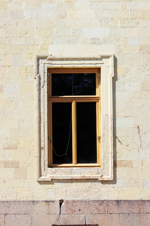 architectural building: new window in the historic architectural building. Stock Photo