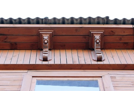 artsy decor trim and classic old wooden house. triangular patterns and wood texture brick color