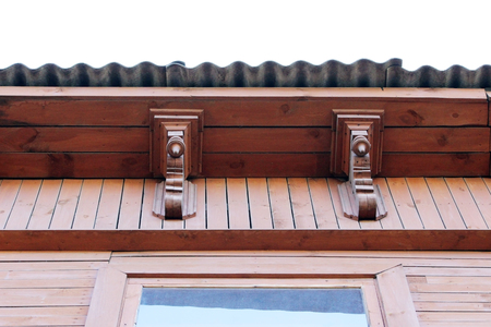 artsy: artsy decor trim and classic old wooden house. triangular patterns and wood texture brick color