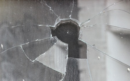 smashed: Vandals smashed the glass of the store window. Stock Photo