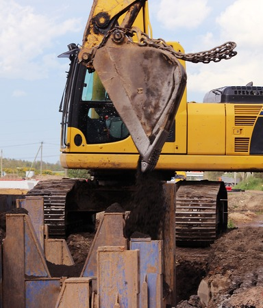 draining: installation of metal structures - immediate support for draining soil at the construction site of the road in marshland Stock Photo