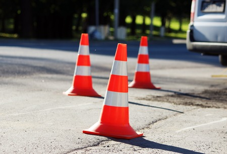 signaling: plastic signaling traffic cone encloses a place in the parking lot for trucks.
