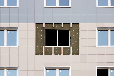 windows in a newly built house. wall structure with insulated non-combustible material basalt fiber tiled