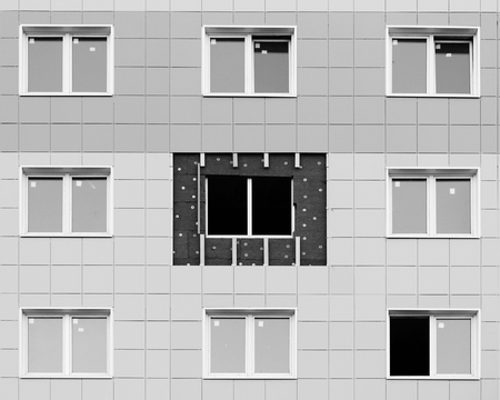 black and white photo windows in a newly built house. wall structure with insulated non-combustible material basalt fiber tiled Stok Fotoğraf - 63735236