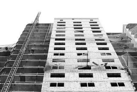 belay: black and white photo rotective catching grid net belay guard tense in the construction of a multistory newly building house