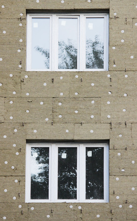 windows in a newly built house. wall structure with insulated non-combustible material basalt fiber tiled.