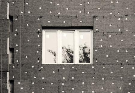 black and white photo windows in a newly built house. wall structure with insulated non-combustible material basalt fiber tiled. Stok Fotoğraf