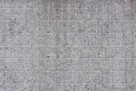 textura: muro grigio moderna come una sovrapposizione trama di piccole pietre su uno sfondo grigio.