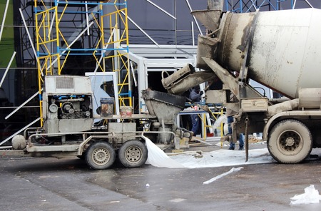 concrete pump and concrete mixer to work together to pouring cement floors in the shopping center for repair Stok Fotoğraf