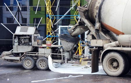 erecting: concrete pump and concrete mixer to work together to pouring cement floors in the shopping center for repair Stock Photo