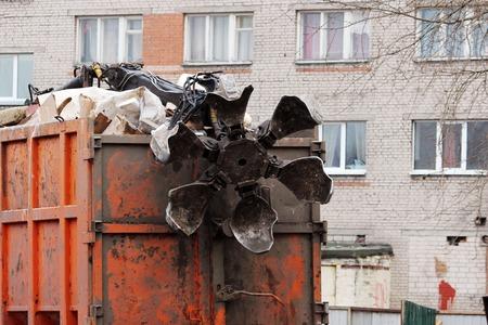 manipulator: orange garbage truck with manual hydraulic manipulator