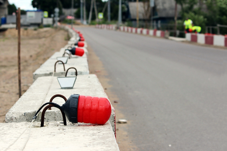 Signal lights on the fundamental blocks of concrete, fencing construction of the viaduct from the existing road