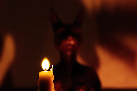 cat goddess: statuette of the goddess Bastet and ritual candle on the altar