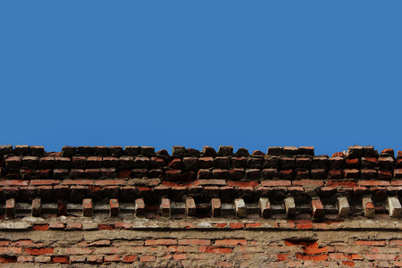 ethnical: upper part of the old brick building against the sky