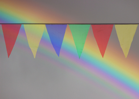 whiff: Multi Colored Triangular Flags Hanging in the Sky at an Outdoor Stock Photo