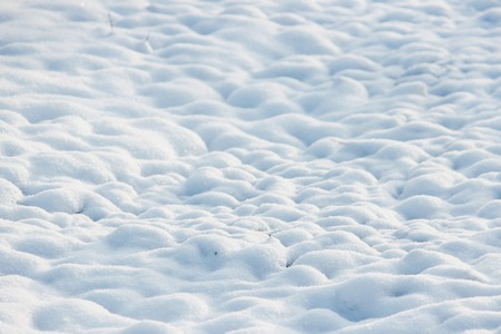 drifts: texture of white snow like small drifts that covered the dug earth.