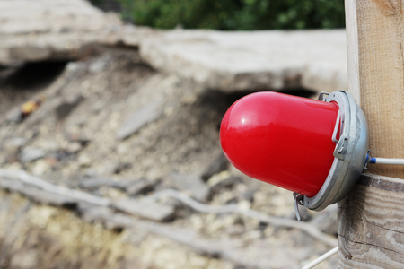 enclosing: Red warning light which enclosing the ditch, where the repair of water pipes.
