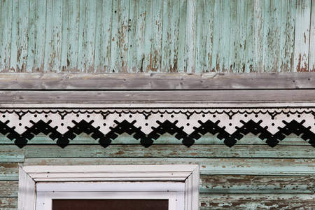 artsy: artsy decor trim and classic old wooden house. triangular patterns and wood texture turquoise color Stock Photo