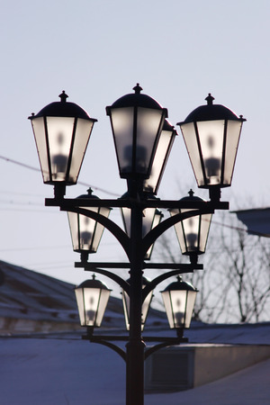 mystique: three ground lights on the town square, illuminated by the sun. Stock Photo