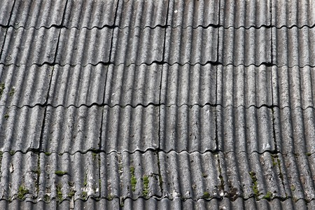 shingles: Flexible shingles of red-brown color on the house roof