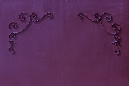 uniform curls: metal violet gates with a pattern in the form of curls covered with paint