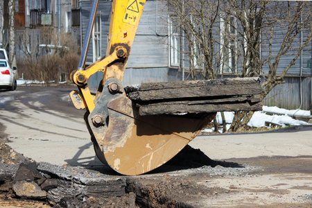 eliminating: opening the road surface when eliminating accidents under the ground. Using of a tractor with a special attachment and an excavator with a bucket.