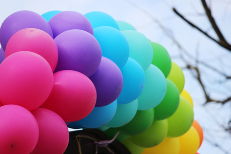 Multicolored balloons adorn the entrance to the cafe Stock Photo - 77583236